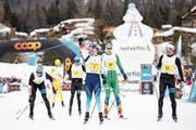 Triumphiert: Dario Cologna (Mitte) feiert den vierten Sieg beim Engadin-Skimarathon. (Bild: Ennio Leanza/Keystone (S-chanf, 10. März 2019))