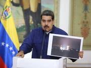 Der Staatschef Venezuelas, Nicolás Maduro, hat am Freitag (Ortszeit) weitere Sicherheitsmassnahmen für kritische Infrastruktur in seinem Land angekündigt. (Bild: KEYSTONE/EPA EFE/MIRAFLORES PALACE/MIRAFLORES PALACE HANDOUT)