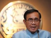 In Thailand regiert seit einem Putsch 2014 das Militär. Der damalige Putschgeneral Prayut Chan-o-cha will als Premierminister im Amt bleiben. (Bild: KEYSTONE/EPA/RUNGROJ YONGRIT)