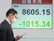 Die Titel von Daiichi Sankyo sind am Freitag an der Börse in Tokio nach der Ankündigung einer Kooperation stark gestiegen. (Bild: KEYSTONE/EPA/EVERETT KENNEDY BROWN)