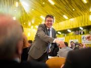 Wunden lecken nach der Schlappe in Zürich - und dann wieder lächeln: SVP-Präsident Albert Rösti an der Delegiertenversammlung im Thurgau. (Bild: KEYSTONE/GIAN EHRENZELLER)
