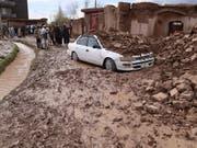 Verheerende Sturzfluten in Afghanistan fordern zahlreiche Todesopfer. (Bild: KEYSTONE/EPA/JALIL REZAYEE)