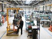 Der Einkaufsmanagerindex PMI bricht im März auf 50,3 Zähler ein. (Bild: KEYSTONE/GAETAN BALLY)