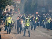 Bei Protesten der «Gelbwesten»-Bewegung kam es am Samstag in Toulouse zu Zusammenstössen zwischen Polizei und Demonstranten. (Bild: KEYSTONE/EPA/GUILLAUME HORCAJUELO)