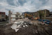 Das Gebäude bei der Migros Bruggen macht einer neuen Überbauung Platz. (Bild: Benjamin Manser)