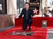 Enthüllte seinen Stern auf dem «Walk of Fame» in Hollywood: US-Komiker Seth MacFarlane. (Bild: KEYSTONE/EPA/ETIENNE LAURENT)