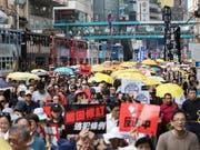 Zehntausende Menschen haben in Hongkong gegen die Regierung der chinesischen Sonderverwaltungsregion demonstriert. (Bild: KEYSTONE/EPA/KYLE LAM)