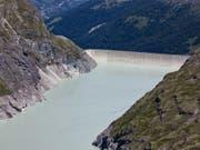 Der Stausee Lac de Dix im oberen Teil des Val d'Hérémence im Kantons Wallis. Die Staumauer Grande Dixence ist mit 285 Metern das höchste Bauwerk der Schweiz. (Bild: Keystone/ALESSANDRO DELLA BELLA)