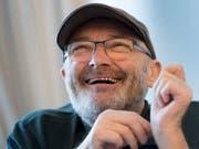 Seit Jahrzehnten im Musikbusiness, mit Genesis und solo: Jetzt wird Phil Collins mit der Ehrendoktorwürde in Graz geehrt. (Bild: KEYSTONE/LAURENT GILLIERON)