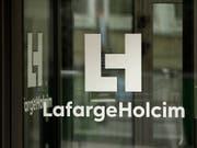 Der Schweizer Baustoffriese LafargeHolcim hat im ersten Quartal dank höherem Umsatz und zusätzlich Kosteneinsparungen überproportional mehr verdient. (Bild: KEYSTONE/EPA/YOAN VALAT)