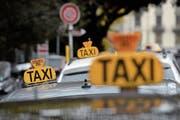 Ein Taxi kommt selten allein. Ein Ungemach ebenso. (Bild: Martial Trezzini, Keystone (Genf, 2014))