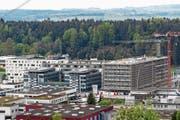 Der D4-Businesspark (links) in Root und daneben der sich im Bau befindende Komplex «Square One». (Bild: Philipp Schmidli (2. Mai 2019))