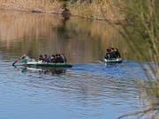 Migranten auf Gummibooten auf dem Rio Grande an der Grenze zwischen Mexiko und dem US-Bundessaat Texas. (Bild: KEYSTONE/EPA/LARRY W. SMITH)