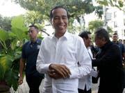 Jetzt ist es offiziell: Indonesiens Präsident Joko Widodo bleibt für fünf weitere Jahre im Amt. (Bild: KEYSTONE/AP/ACHMAD IBRAHIM)