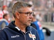 Trainer Urs Fischer hält den Ball zwar bewusst flach. Das Ziel von Union Berlin nach seiner verblüffenden Zweitliga-Saison ist aber klar: Aufstieg in die erste Bundesliga (Bild: KEYSTONE/EPA/RONALD WITTEK)