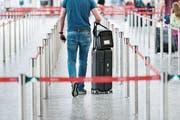 Check-in am Flughafen Zürich. (Bild: Christian Beutler/Keystone)