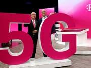 Die Spitze der Deutschen Telekom zeigt sich zufrieden mit der Entwicklung des Konzerns. (Bild: KEYSTONE/DPA/OLIVER BERG)