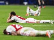 Aus dem Traum wurde ein Albtraum: Die Ajax-Spieler nach dem späten Gegentor (Bild: KEYSTONE/EPA ANP/OLAF KRAAK)