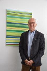 Vielfältig-bunt ist das Bild im Büro von Christoph Ackermann. Bunt und vielfältig ist seine neue Tätigkeit als Präsident des Verbandes der St.Galler Volksschulgemeinden. (Bild: Zita Meienhofer)