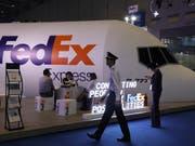 Der amerikanische Logistikanbieter Fedex kommt in China immer mehr unter Druck. (Bild: KEYSTONE/AP/NG HAN GUAN)