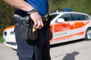 Mitarbeiter der Kantonspolizei St.Gallen konnten den Unfallverursacher ausfindig machen. (KEYSTONE/Gian Ehrenzeller)