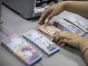 Mega-Inflation: Venezuela muss binnen Jahresfrist schon wieder neue Geldscheine in den Umlauf bringen. (Bild: KEYSTONE/EPA EFE/MIGUEL GUTIERREZ)
