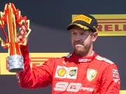 Sebastian Vettels säuerliche Miene auf dem Podest in Montreal (Bild: KEYSTONE/AP The Canadian Press/PAUL CHIASSON)