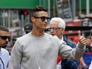 Der portugiesische Fussballstar Christiano Ronaldo wird wegen eines Vergewaltigungsvorwurfs vor ein US-Gericht zitiert. (Bild: KEYSTONE/AP/LUCA BRUNO)