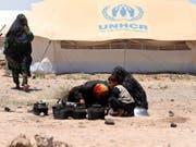 Die Zahl der Flüchtlinge ist einem Uno-Bericht zufolge im vergangenen Jahr auf ein Rekordhoch gestiegen. Ende 2018 gab es weltweit 70,8 Millionen Flüchtlinge, Vertriebene und Asylbewerber. (Bild: Keystone/EPA/JALIL REZAYEE)