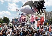 Hunderttausende Iraner protestierten gegen Trumps geplanten Nahost-Friedensplan. Bild: Abedin Taherkenareh/EPA (Teheran, 31. Mai 2019)