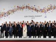 Der Handelskonflikt zwischen den USA und China, der Klimawandel und die Kriegsgefahr in der Golfregion stehen im Mittelpunkt des G20-Gipfels, der am Freitag im japanischen Osaka begonnen hat. (Bild: KEYSTONE/EPA POOL/ANDY RAIN / POOL)