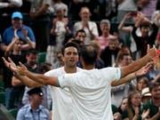 Die Erlösung nach einem epischen Final: Juan Sebastian Cabal (re.) und Robert Farah jubeln in Wimbledon über ihren ersten Grand-Slam-Titel (Bild: KEYSTONE/EPA/NIC BOTHMA)