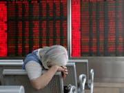 Am Montag präsentierte das chinesische Statistikamt die jüngsten Konjunkturzahlen. (Bild: KEYSTONE/EPA/WU HONG)