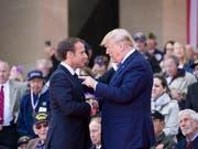 US-Präsident Donald Trump attackiert Frankreichs Präsident Emmanuel Macron wegen der Einführung einer neuen Steuer in Frankreich und kündigte unter anderem Strafzölle auf den Import französischer Weine an. (Bild: KEYSTONE/AP/ALEX BRANDON)