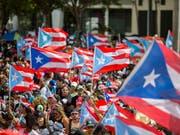 Nach der Rücktrittsankündigung von Ricardo Rosselló aufgrund von Massenprotesten rätselt Puerto Rico derzeit über den Nachfolger auf dem Gouverneurposten. (Bild: KEYSTONE/AP/DENNIS M. RIVERA PICHARDO)