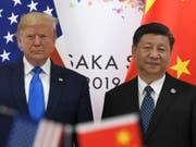 Da herrschte noch so etwas wie Minne: US-Präsident Donald Trump und sein chinesischer Amtskollege Xi Jinping am G-20-Gipfel in Osaka. (Bild: KEYSTONE/AP/SUSAN WALSH)