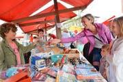 Fröhliche Gesichter wie am letztjährigen Löwenstrassenfest werden auch diesen Freitag wieder zwischen den Ständen zu sehen sein. (Bild: Donato Caspari, 17.08.2018)