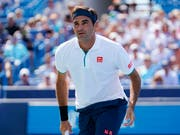 Trotz seiner schnellsten Niederlage seit 2003 nahm Roger Federer das frühe Ausscheiden in Cincinnati relativ gelassen (Bild: KEYSTONE/AP/JOHN MINCHILLO)