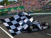 Im nächsten Jahr werden in 22 Formel-1-Rennen die Sieger abgewunken (Bild: KEYSTONE/AP AFP/ANDREJ ISAKOVIC)