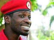 Der Popstar und Politiker Bobi Wine wird der Verhöhnung des ugandischen Langzeit-Präsidenten beschuldigt. (Bild: KEYSTONE/AP/RONALD KABUUBI)