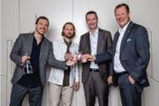 Die Geschäftsleitungen von WfW und Schindler freuen sich über die Zusammenarbeit. V.l.n.r.: Joel Dickenmann (Co-Geschäftsleiter Schweiz, WfW), Morris Etter (Co-Gründer und Vorsitz Geschäftsleitung, WfW), Patrick Hess (CEO Schindler Schweiz), Thomas Oetterli (CEO Schindler Group) (Foto: Philipp Schmidli)