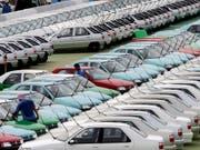 Sinkende Absatzzahlen führen beim Peugeot-Dongfeng-Joint-Venture zu drastischen Restrukturierungsmassnahmen. (Bild: KEYSTONE/AP COLOR CHINA PHOTO)