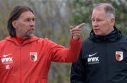 Holten diesen Sommer zwei Spieler aus der Schweiz: Martin Schmidt (links) und Sportdirektor Stefan Reuter. (Keystone)