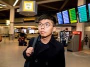 Der Aktivist aus Hongkong, Joshua Wong, ist am Montag in Berlin angekommen. (Bild: KEYSTONE/AP dpa/CHRISTOPH SOEDER)