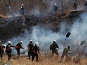 In Bolivien sind seit August zwei Millionen Hektar Wald und Grasland durch Brände zerstört worden. Umweltschützer geben der Regierung die Schuld dafür. Per Gesetz hatte die Regierung das Abbrennen von Wald- und Weideflächen für landwirtschaftliche Zwecke gefördert. (Bild vom 30. August) (Bild: KEYSTONE/AP/JUAN KARITA)