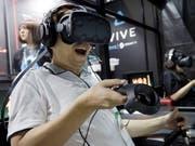 Vom neuen ultraschnellen Mobilfunknetz der 5. Generation sollen auch Online-Gamer profitieren. (Bild: KEYSTONE/AP/EUGENE HOSHIKO)
