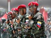 Venezolanische Soldaten bei einer Parade in der Hauptstadt Caracas Anfang Juli. (Bild: KEYSTONE/AP/ARIANA CUBILLOS)