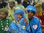 Ein indonesisches Paar vor ihrer Hochzeit. In Zukunft muss die Braut mindestens 19 Jahre alt sein, um heiraten zu können. (Bild: Keystone/AP/DITA ALANGKARA)