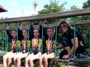 Die K3-Turnerinnen; von links: Sara Droese, Valeria Gamma, Livia Arnold, Silja Arnold und Trainerin Vanessa Baumann. (Bild: PD)
