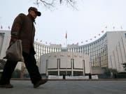 China will ähnliche Digitalwährung wie Facebook herausbringen. (Bild: KEYSTONE/AP/VINCENT THIAN)